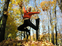Jump girl in autumn wood. ÑŽ. sun royalty free stock photography