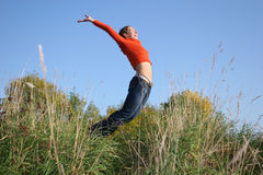 Jump girl in grass royalty free stock photos