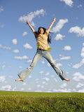 Jump girl with hair on sky 2 Royalty Free Stock Image
