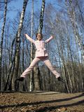 Jump girl in park stock image