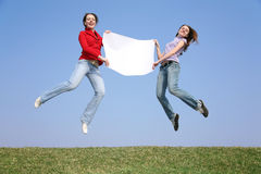 Jump girls with paper Royalty Free Stock Photography