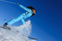 Jump of glad young skier Stock Photos