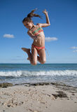 Jump of joy on the beach. Young girl full of joy is jumping on a nice beach in Mexico Royalty Free Stock Photo
