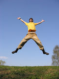 Jump guy on meadow royalty free stock photos