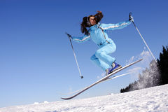 Jump of happy young skier Royalty Free Stock Image