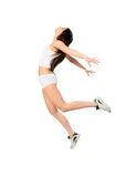 Jump for Health. A young  woman jumping on white background Royalty Free Stock Image