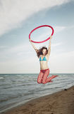 Jump with hula hoop Stock Photography