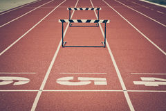 Jump hurdle. On running track in stadium royalty free stock photo