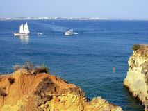 Jump II. Jump for the water in Batata beach, Lagos, Portugal royalty free stock photos