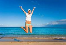Jump for joy. Female jumping for joy smiling and happy on tropical beach Royalty Free Stock Photography