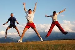 Jump for joy. Three people jump for joy Royalty Free Stock Photography