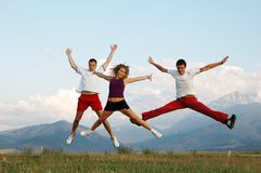 Jump for joy. Three people jump for joy stock photos
