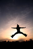 Jump for Joy. Silhouette Girl Stock Photography