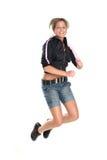 Jump for joy. Beautiful teenage girl jumping, isolated on white Stock Photo