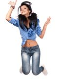 Jump for joy. Cute teenage girl jumping for joy, isolated on white Stock Photography