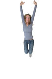 Jump For Joy. Teenage girl on white background jumping in the air for joy. Happy victory Stock Images