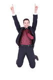 Jump of joy!. Business man jumping in joy on white background Royalty Free Stock Image