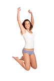 Jump for joy. Beautiful young woman jumping, isolated on white Royalty Free Stock Photos