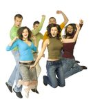 Jump for joy. Group of 6 happy teenagers. They're jumping with hands up and shouting. White background. Whole bodies visible Stock Photo
