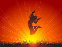 Jump for joy. Silhouette of a female jumping for joy Royalty Free Stock Photos