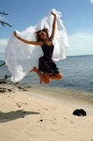 Jump for Joy at beach Stock Images