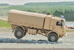 Jump of Kamaz sport truck Stock Photo