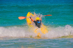 Jump kayak through wave Stock Photography