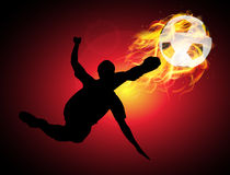 Jump kicking the fire ball in the air. On red background Royalty Free Stock Photos