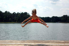 Jump at lake Stock Images