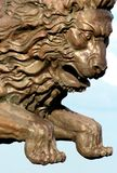 Jump of a lion. Figure on a nose of a sailing vessel on a background of the sky Stock Image