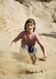 Jump of little girl in the sand Royalty Free Stock Image