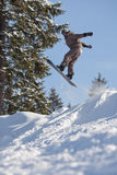 Jump of man snowboarder. Man snowboarder jumping. Blue sky Royalty Free Stock Photo