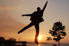 Jump man on sunset Stock Photography