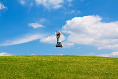 Jump in the meadow Stock Images