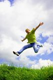 Jump of men. Jump of happiness people on blue sky and green grass background Stock Photo