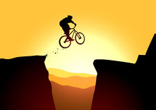 Jump in mountain on the bike Royalty Free Stock Photos