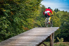 Jump with a mountain bike Royalty Free Stock Image