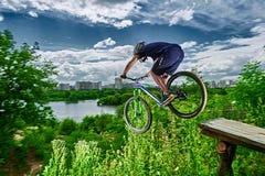Jump on a mountain bike Stock Photo