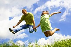 Jump Of Two People Stock Photo