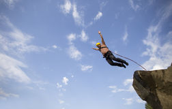 Jump off a cliff. Jump off a cliff into a canyon with a rope Stock Photo