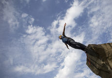 Jump off a cliff. stock photography