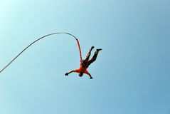 Jump off a cliff with a rope.Bungee jumping Stock Photography