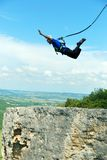 Jump off a cliff with a rope.Bungee jumping Royalty Free Stock Photography