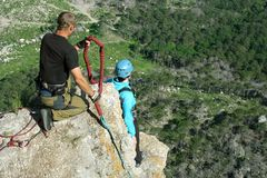Jump off a cliff with a rope.Bungee jumping Stock Photo