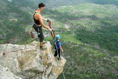 Jump off a cliff with a rope. Stock Photos