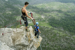 Jump off a cliff with a rope. Royalty Free Stock Photography