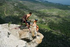 Jump off a cliff with a rope. Stock Photo