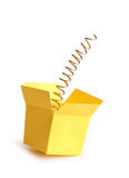 Jump Out. Metal spring inside open yellow paper box. Isolated on white with clipping path Stock Photography