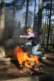 Jump over fire. Boy jumping over fire Royalty Free Stock Image