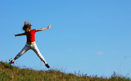 Jump over a grass field Stock Image